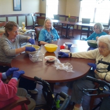 Baking Birthday Cakes-Willows of Arbor Lakes-Ladies baking and gossiping